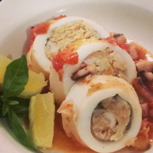 Squid stuffed with prawns on a fresh tomato concasse sauce