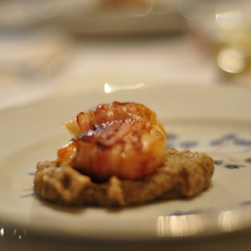 Scallops wrapped in Alto Adige pancetta